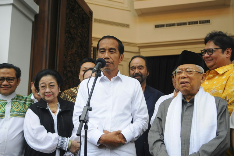 Indonesia's Joko Widodo, who has won a second term as president, spoke to reporters with his running mate Ma'ruf Amin (right) in Jakarta three days before the official results were announced. (AFP photo)