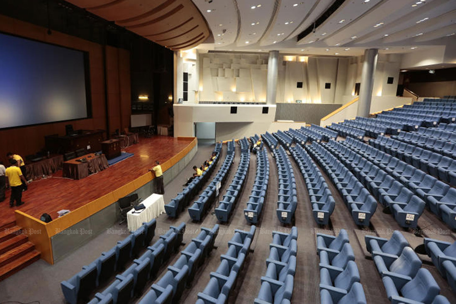 Officials prepare the auditorium at TOT Plc on Chaeng Watthana Road for the first sessions of the Senate and House of Representatives on Friday and Saturday. (Photo by Patipat Janthong)