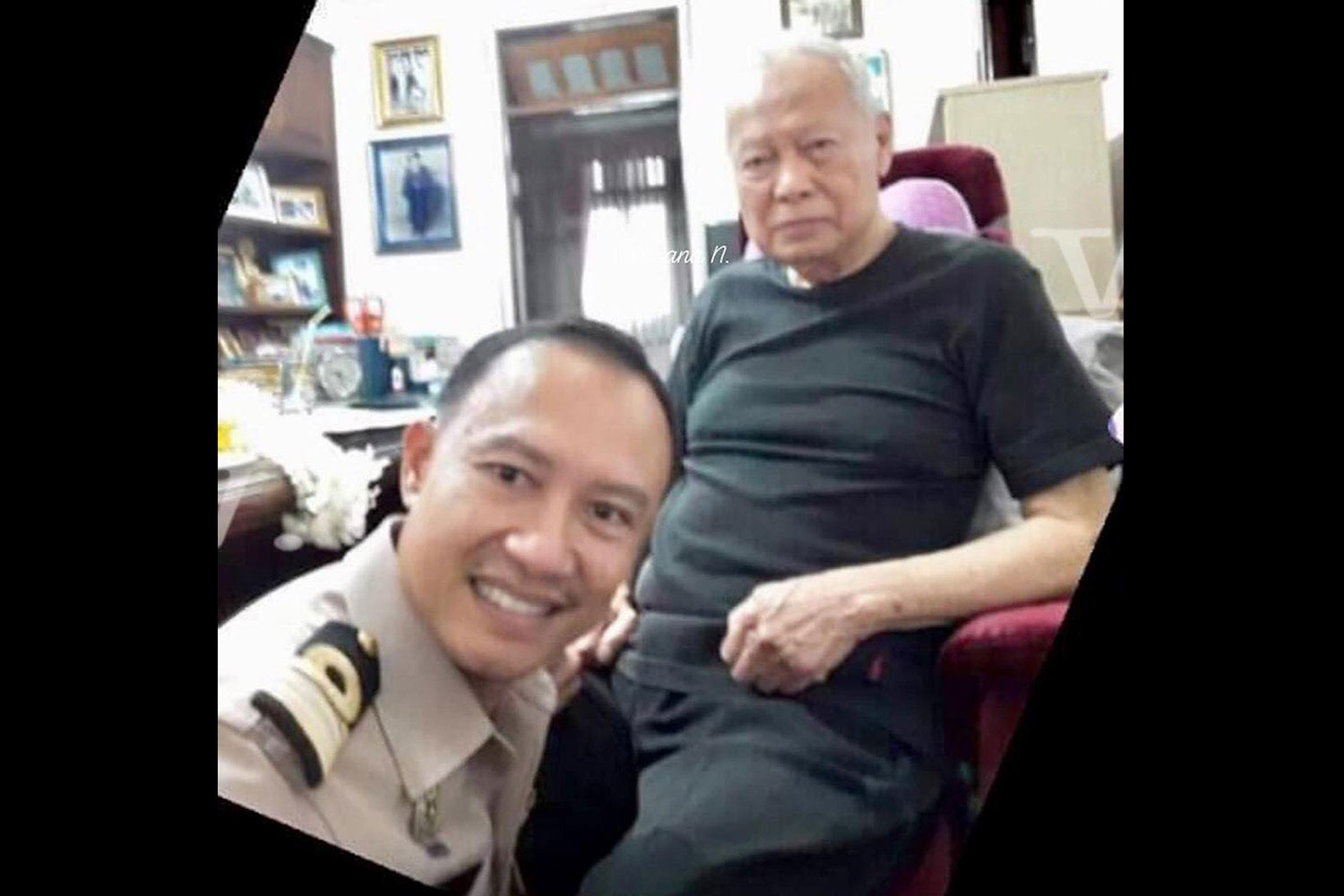 Cdr Surithichai Khlai-udom (left) poses with Privy Council president and statesman Prem Tinsulanonda in a photo he later used as his Facebook profile picture. (Photo supplied)