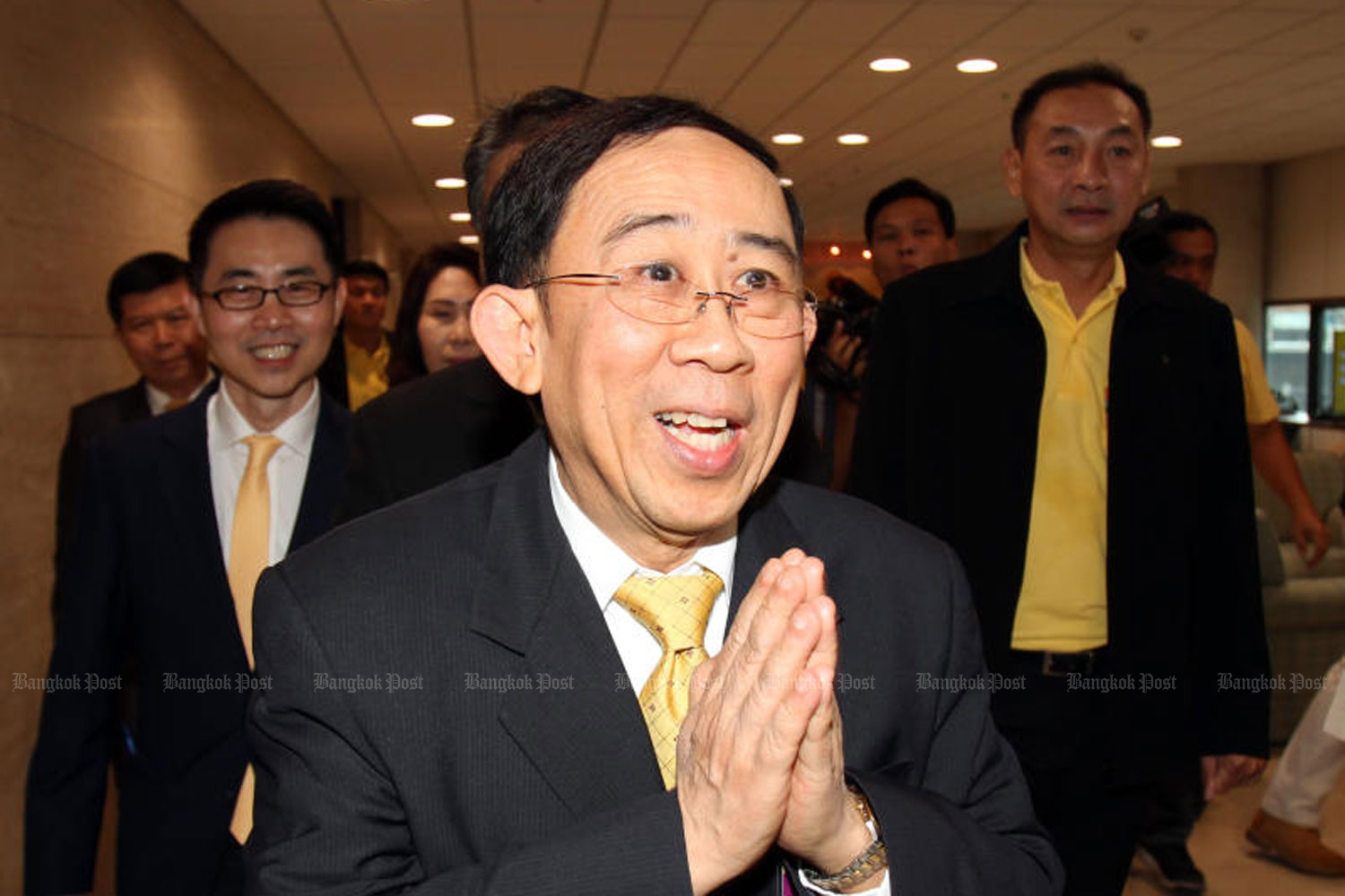 Mingkwan Sangsuwan, then New Economics Party leader, gives a wai when he led the MPs of his party to report themselves at a new Parliament building in Bangkok on May 13 after the Election Commission endorsed them. He resigned as party leader, effective on Thursday. (Photo by Tawatchai Kemgumnerd)