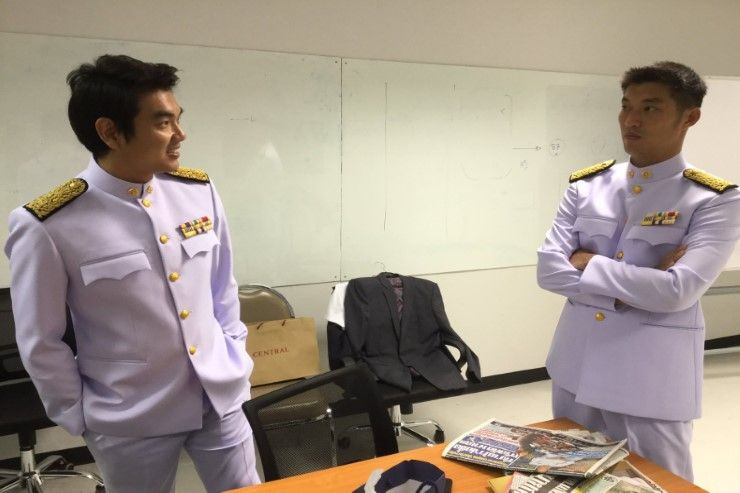 Future Forward Party leader Thanathorn Juangroongruangkit (right) and secretary-general Piyabutr Saengkanokkul try the uniforms of political officials on May 12 ahead of the opening of Parliament. It remains unknown when Mr Thanathorn will be able to wear his after the court's ruling on Thursday. (Photo from @Pannika_FWD twitter)