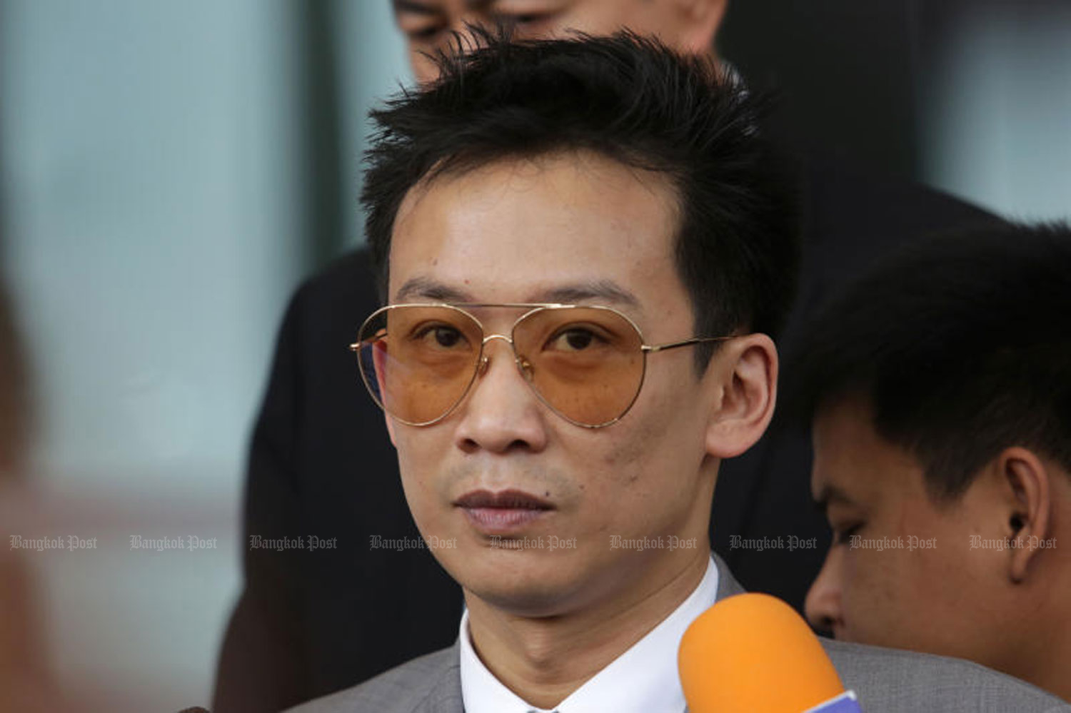 Panthongtae 'Oak' Shinawatra talks to reporters as he turns up at the Central Criminal Court for Corruption and Misconduct Cases to enter his plea in a money laundering case in November last year. (Photo by Wichan Charoenkiatpakul)