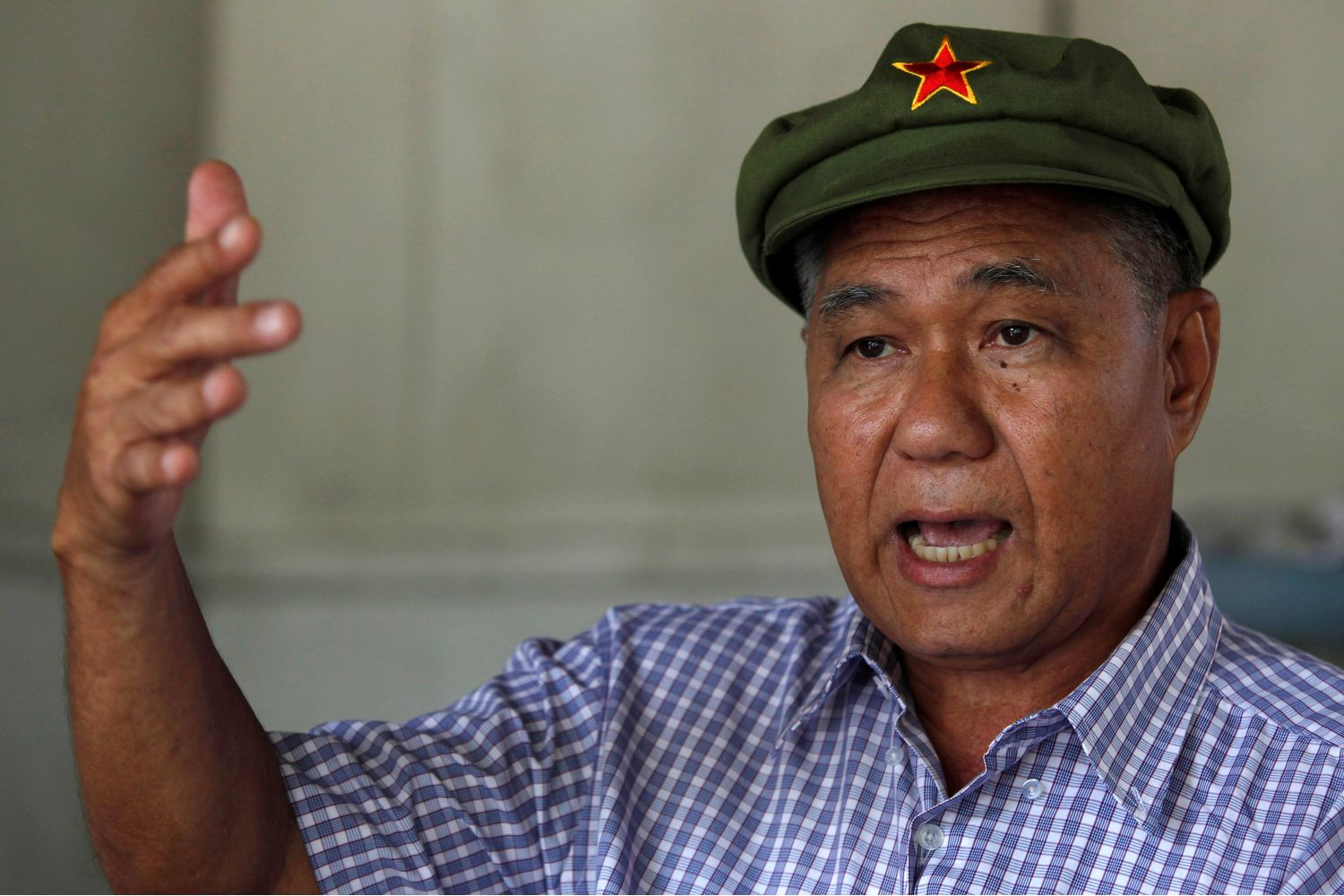 Former communist and political prisoner Surachai Danwattananusorn gestures during an interview at his home in Bangkok on Aug 25, 2010. (Reuters photo)