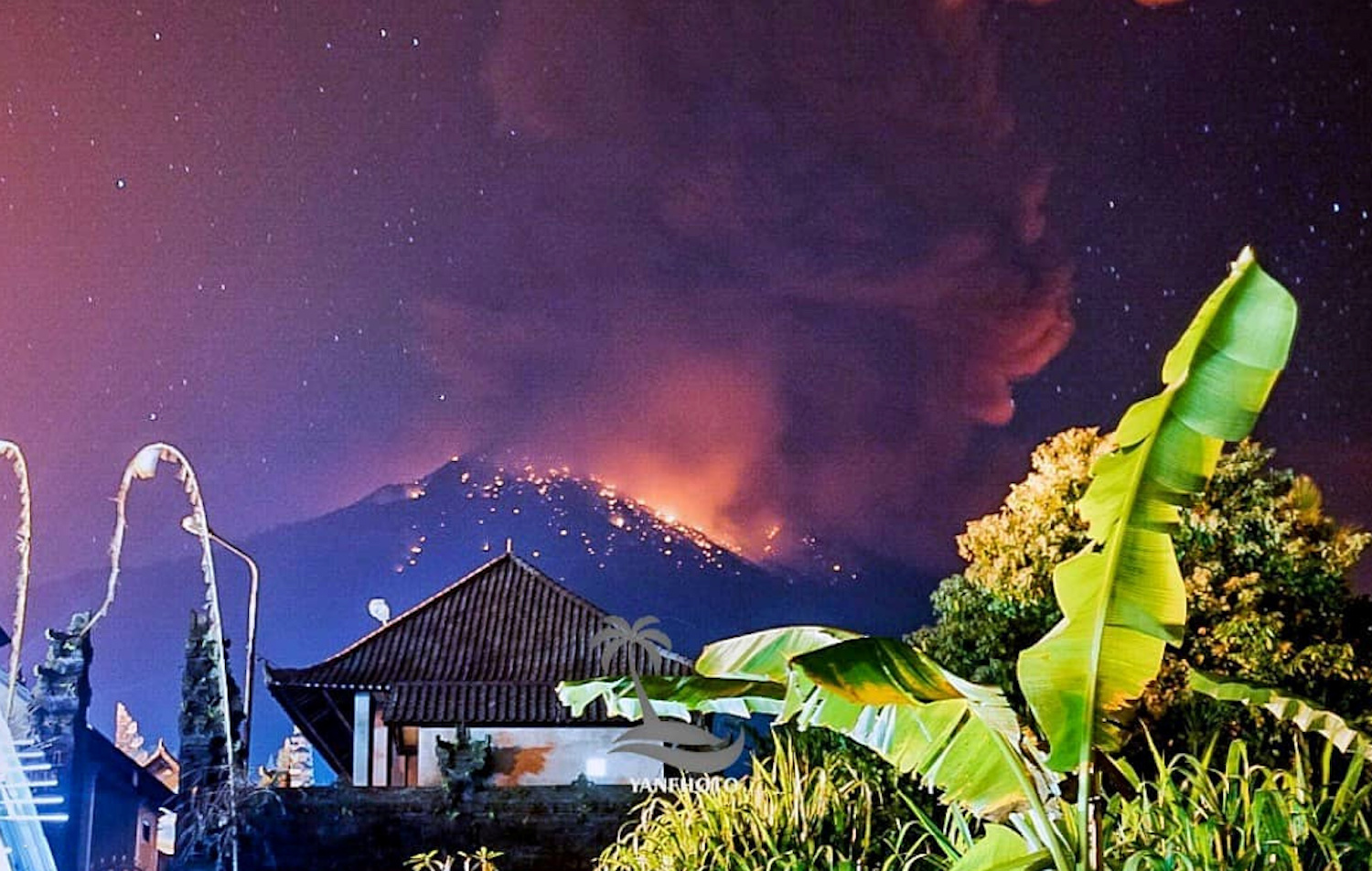 Thick smoke and a glow from lava are seen as Mount Agung erupts in Karangasem Regency of Bali late Friday night, in a picture obtained from social media. (Wayan Kartika/via Reuters)