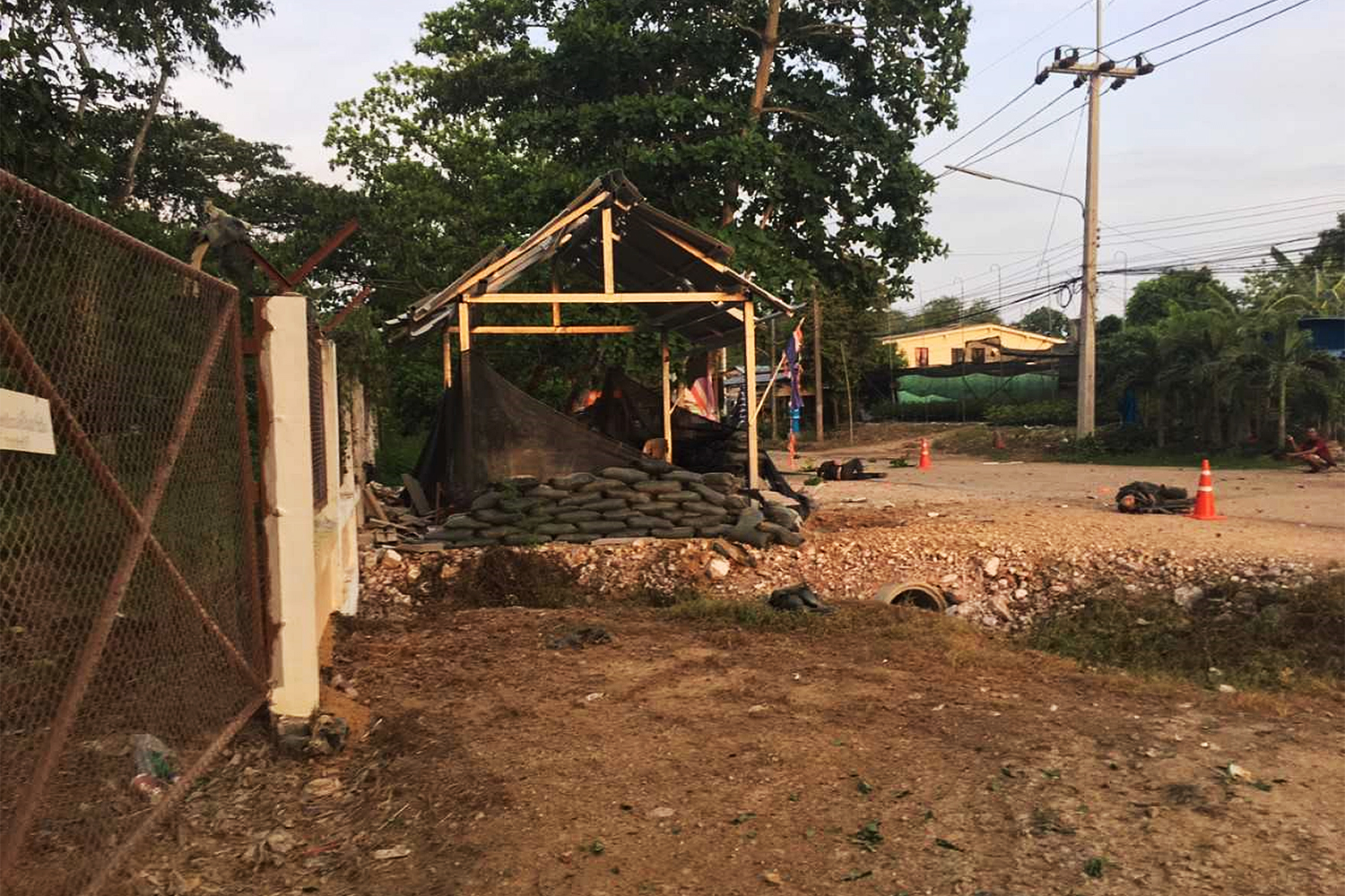 A policeman was killed and four others were injured when a bomb placed in a bunker sandbag at the security booth was detonated in Chana district of Songkhla province on Sunday evening. (Photo by Assawin Pakkawan)