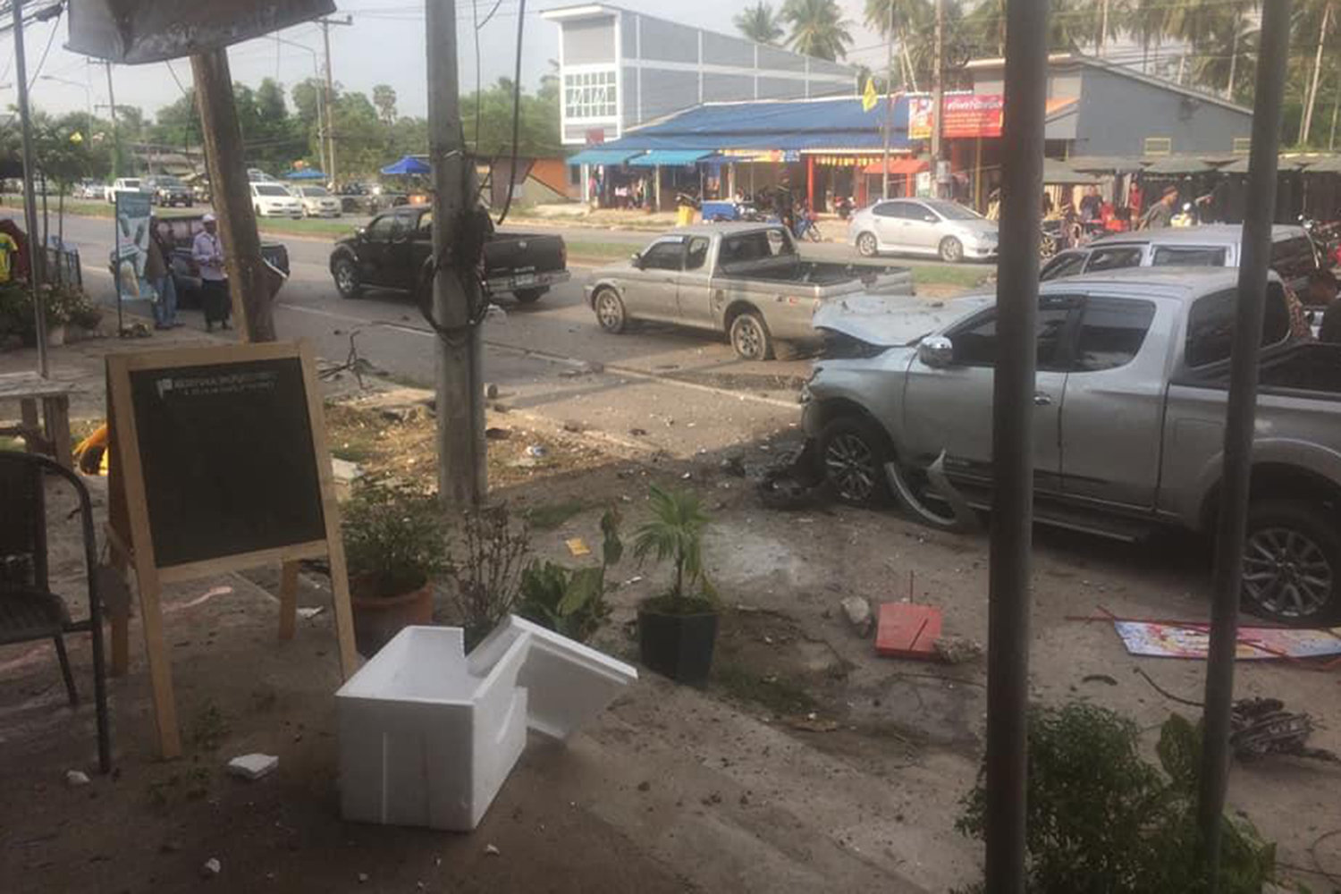 A bomb explodes at an evening market in Pattani's Nong Chik district on Monday. (Photo from @SuntiPattani Facebook account)