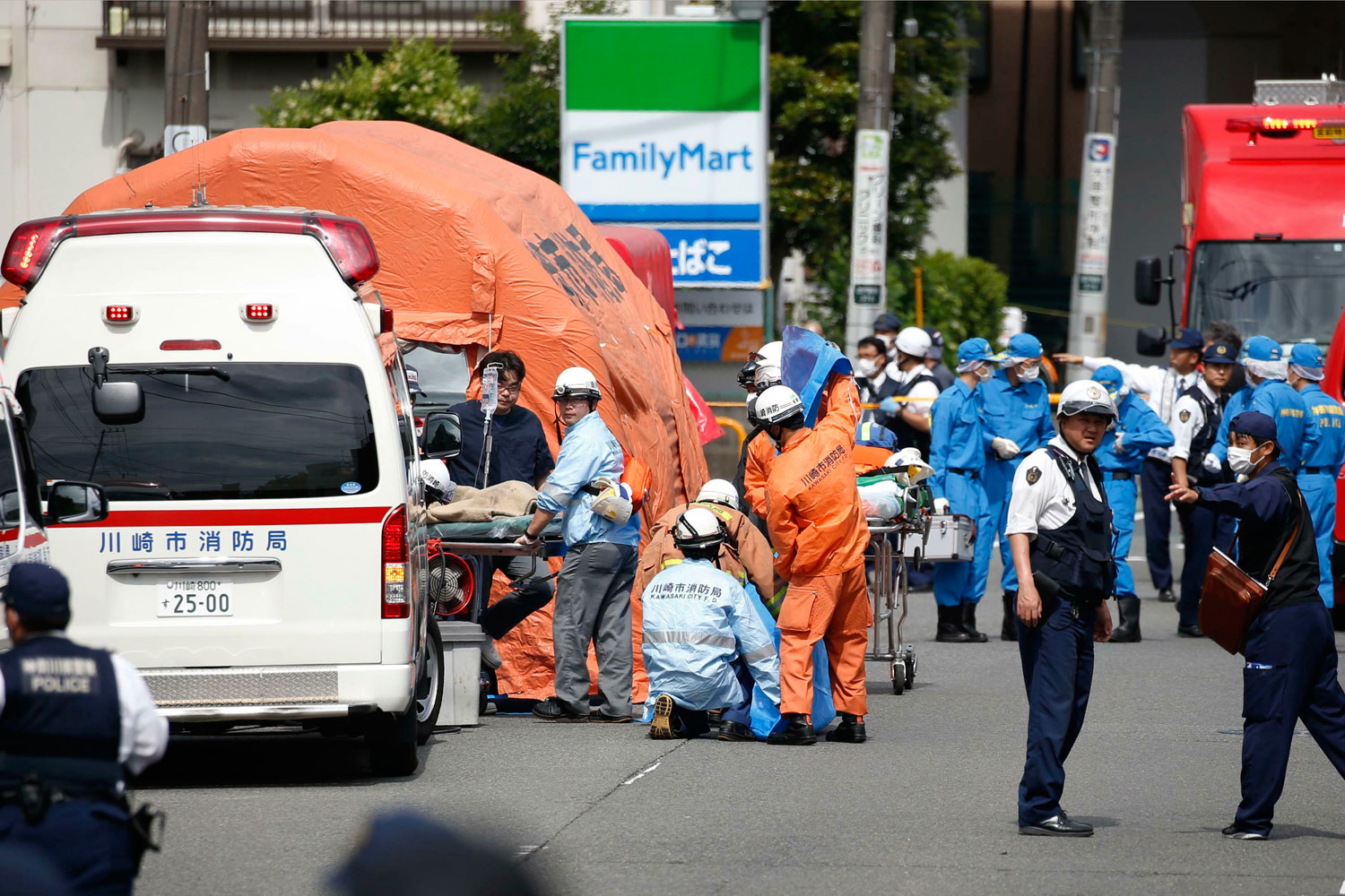 Rescuers work at the scene of an attack in Kawasaki city near Tokyo on Tuesday. (Kyodo News via AP photo)