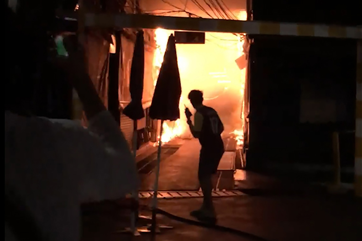 An image taken from a video clip shows the fire at Chatuchak weekend on Sunday night. (Younes Parvin via AP photo)