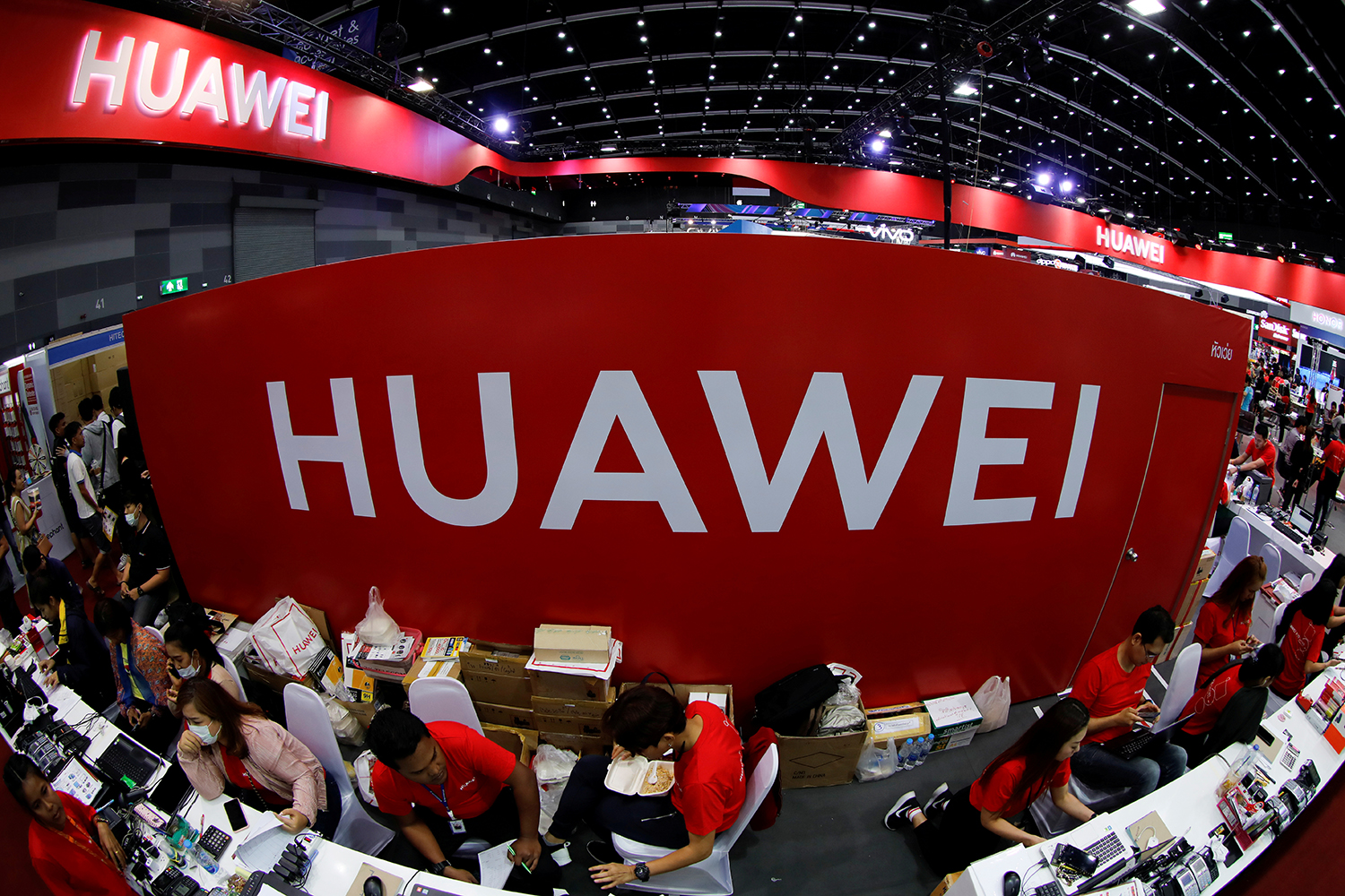 Workers sit at the Huawei stand at Thailand Mobile Expo at Bitec Bangna. The event ended on Sunday. (Reuters photo)