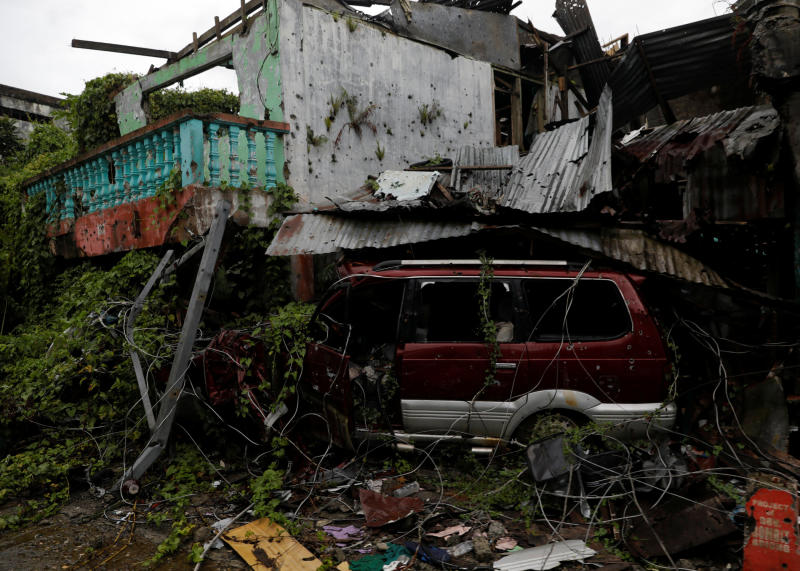 A dilapidated building and car are seen in the war-torn area of Marawi City, Lanao province, Philippines, May 14, 2019. The city remains abandoned two years after pro-Islamic State militants began their attacks on May 23, 2017. (Reuters file photo)