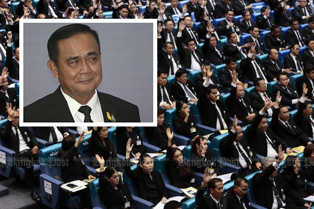 MPs and senators elected Gen Prayut Chan-o-cha Thailand's Prime Minister at the end of their joint session at the TOT auditorium on Wednesday. (Photo by Patipat Janthong) Inset: Gen Prayut smiles after his speech for the opening ceremony of Anti-Human Trafficking Day in Bangkok on Wednesday. (AP photo)