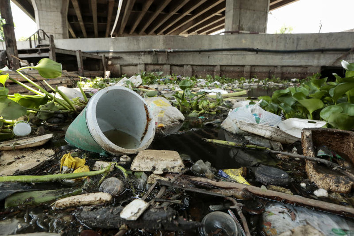Masses of garbage float on Klong Lat Phrao underneath the Ram Intra expressway. Parts of the canal are filled with rubbish that has been blamed for clogging the city's flood water drainage system in the area. (Photo by Patipat Janthong)