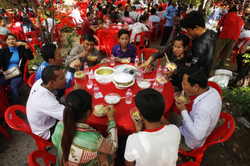 Cambodian garment workers eat noodle at a Buddhist pagoda at outside Phnom Penh, Cambodia, on Sunday. (AP photos)
