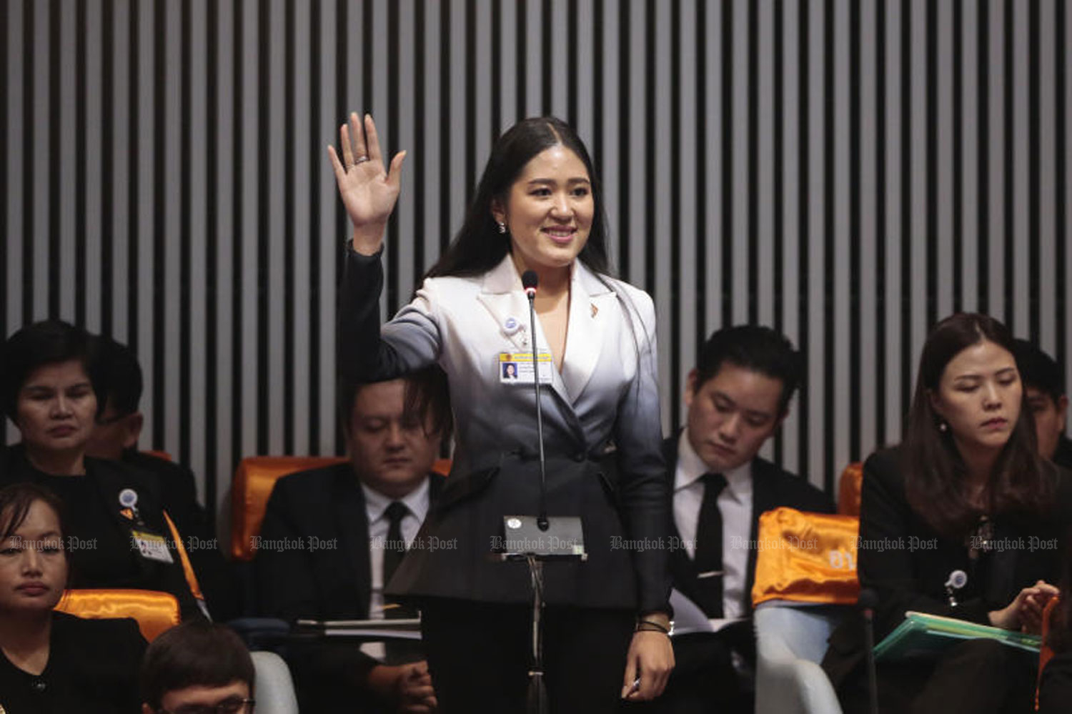 Future Forward Party MP Pannika Wanich raises her hand to speak at a parliamentary session in Bangkok last Wednesday. (Photo by Patipat Janthong)
