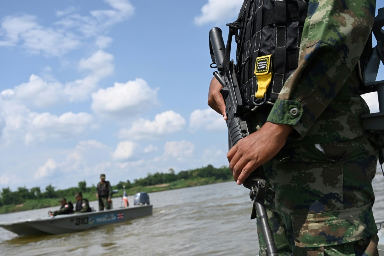 An armed Thai navy officer patrols along the Mekong river in Nakhon Phanom province, where drug gangs ship meth from Laos to Thailand.