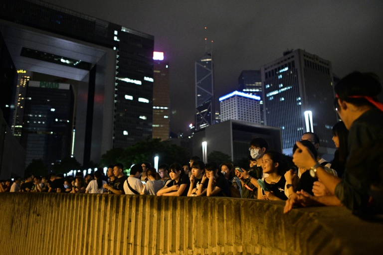People gather outside the government headquarters in Hong Kong late on June 11, 2019, just hours before lawmakers debate a divisive plan to allow extraditions to China.