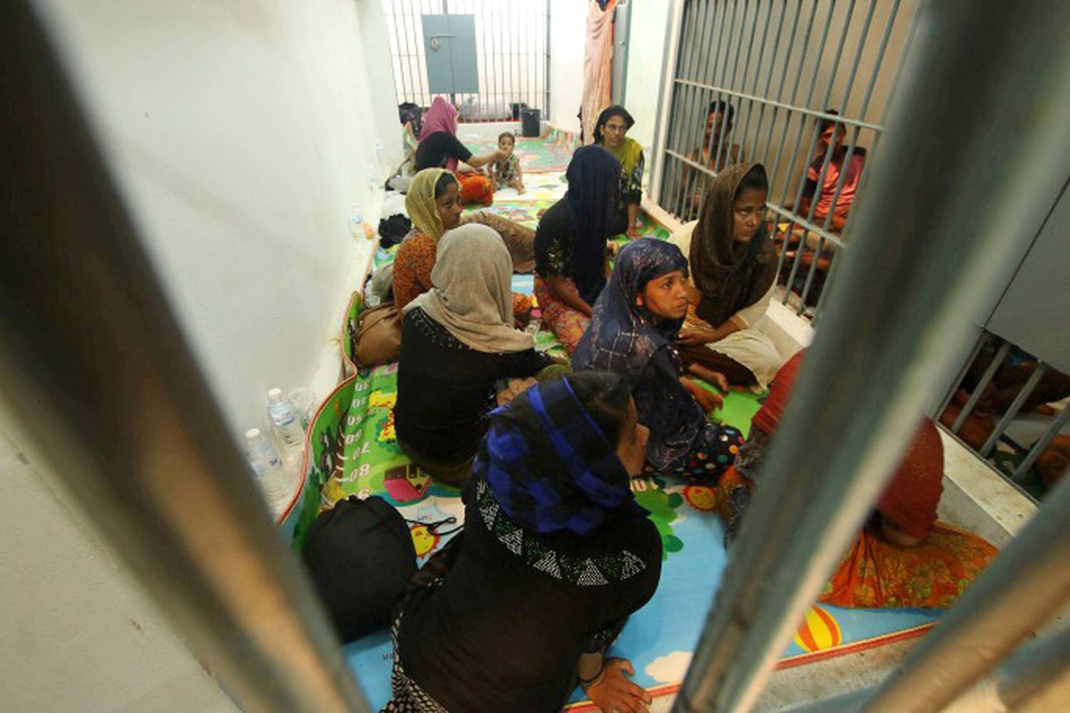 Rohingya people are seen detained in a police station after a fishing boat carrying more than sixty Rohingya refugees was found beached at Rawi island, part of Tarutao national park in Satun province on Wednesday. (Reuters photo)