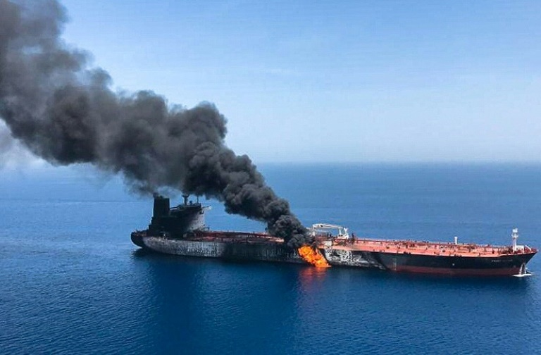 A picture obtained by AFP from Iranian News Agency ISNA on June 13, 2019 reportedly shows fire and smoke billowing from the Norwegian-owned Front Altair tanker, one of two vessels hit by suspected attacks in the waters of the Gulf of Oman.