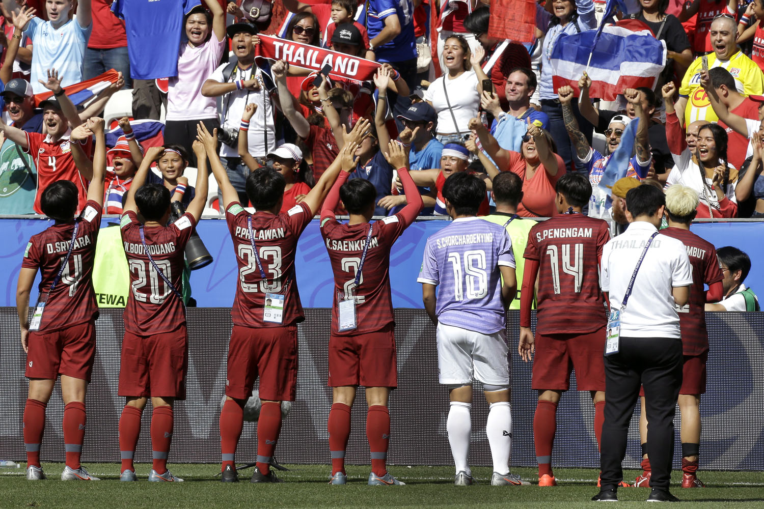 Thailand's players celebrate in front of their supporters after the Women's World Cup Group F soccer match between Sweden and Thailand at the Stade de Nice in Nice on Sunday. (AP photo)