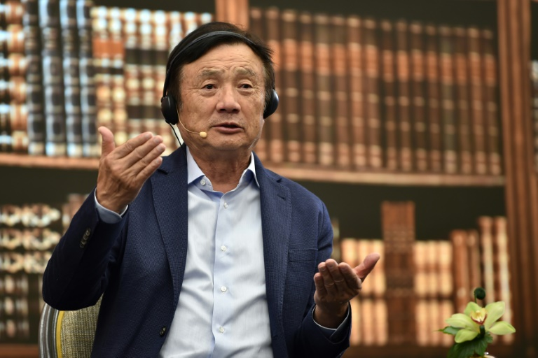 Huawei's founder says overseas smartphone sales have tumbled after US pressure on the Chinese firm.