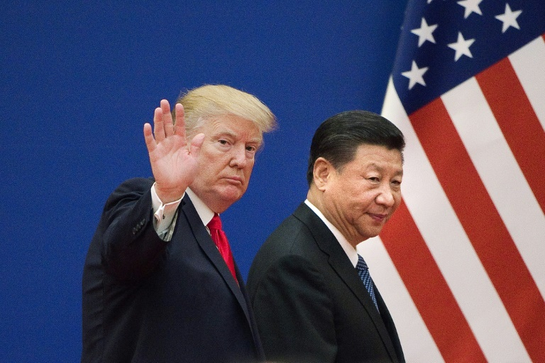US President Donald Trump says he and China's President Xi Jinping (R) plan to have an