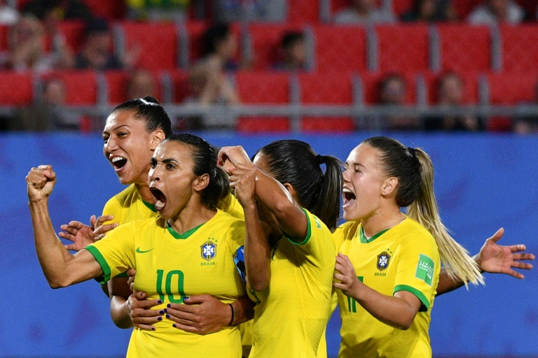Record-breaking Marta fires Brazil into World Cup knockouts