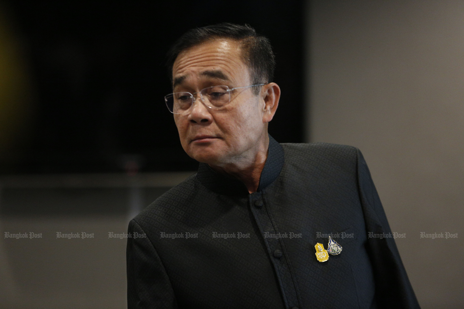 Prime Minister Prayut Chan-o-cha checks the final version of the cabinet lineup.