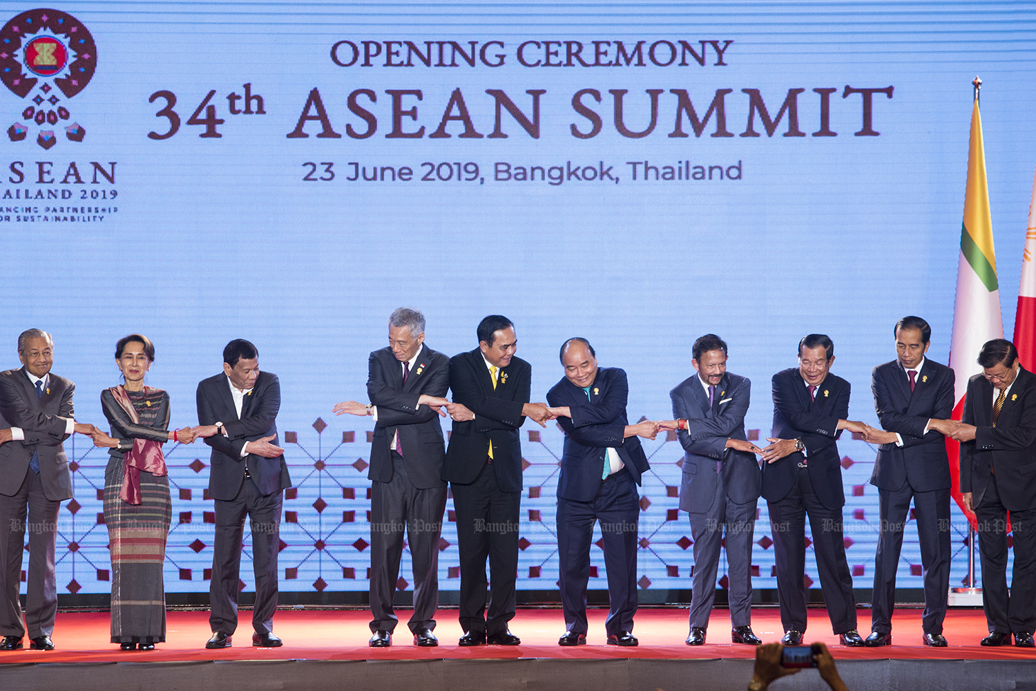 Leaders pose for a group photo during the opening ceremony of the Asean summit at the Athenee Hotel in Bangkok on Sunday. (Photo by Pattarapong Chatpattarasill)