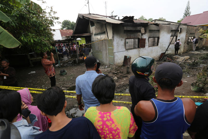 Locals look at a house used as a factory producing matchsticks after a fire swept through, at Binjai district in Langkat, North Sumatra province, Indonesia, on Friday. (Antara Foto/Adiva Niki/ via REUTERS)
