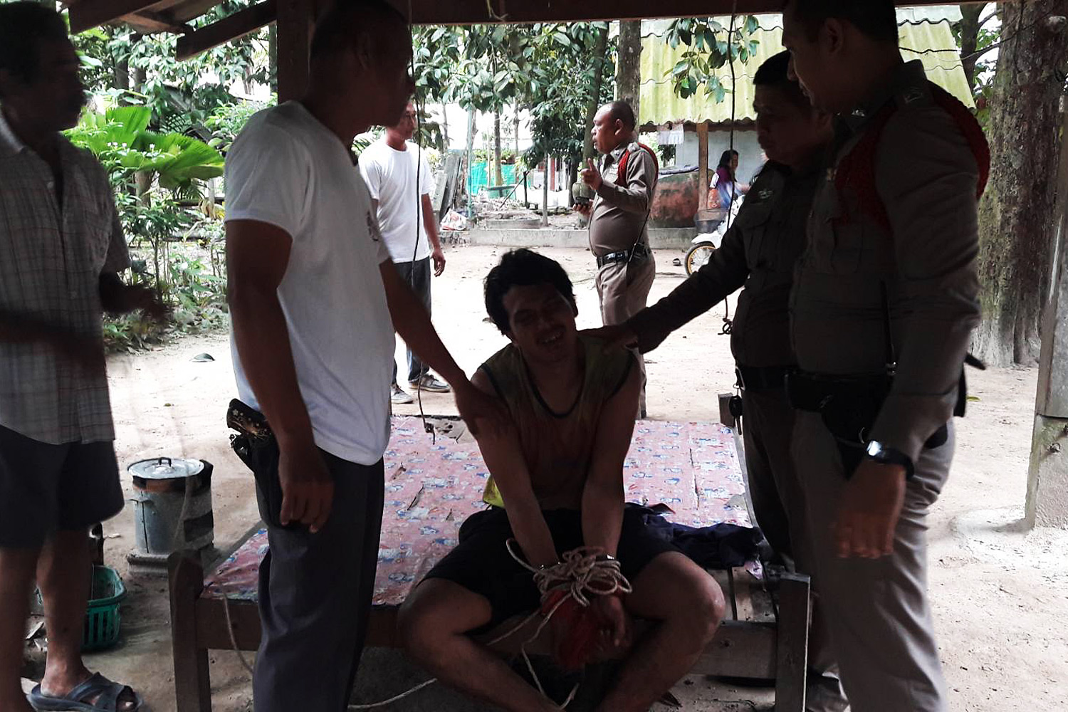 A man believed to be high on drugs killed his son and injured his wife with an axe in Nakhon Si Thammarat on Sunday. (Photo by Nujaree Raekrun)