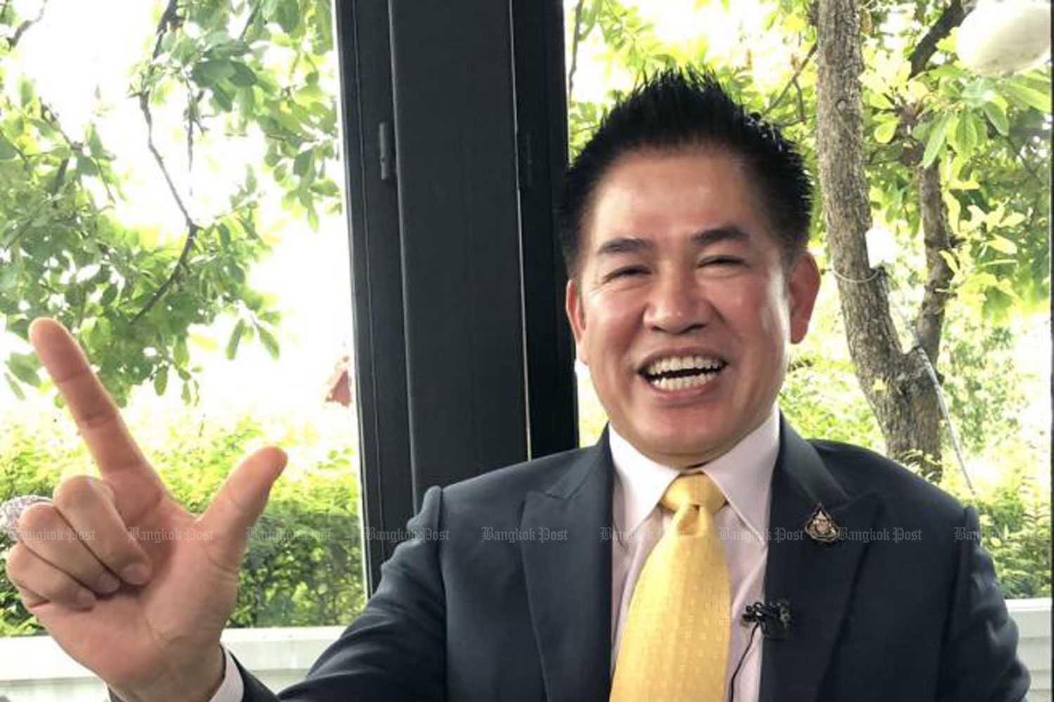 PPRP MP for Phayao, Thammanat Prompao — who is said to be the party executives' most trusted MP — gestures during an interview with the 'Bangkok Post'.(Photo by Wassana Nanuam)