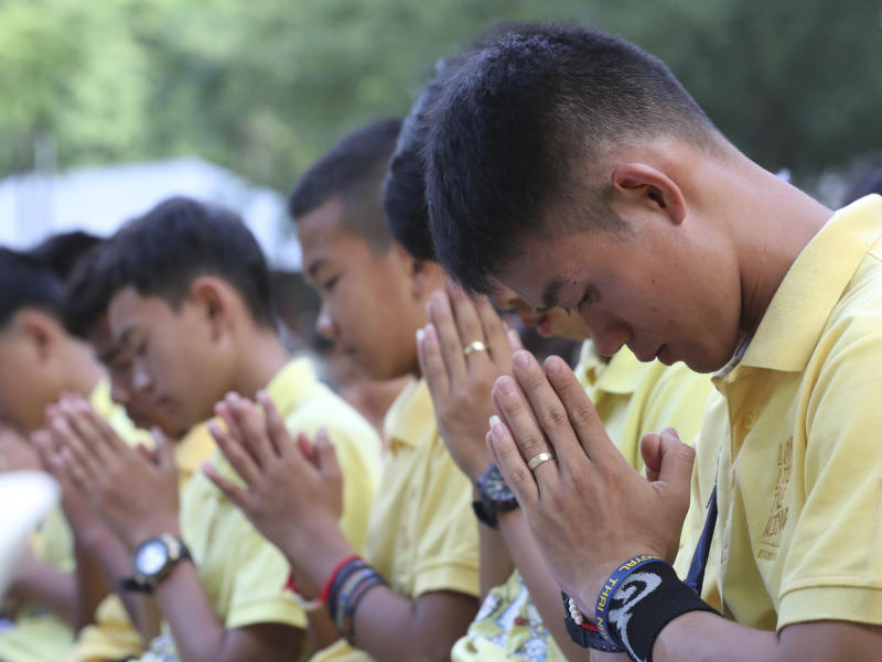 Members of the Wild Boars soccer team who were rescued from a flooded cave pray during a religious ceremony near the Tham Luang cave in Mae Sai, Chiang Rai province, on Monday. (AP photos)