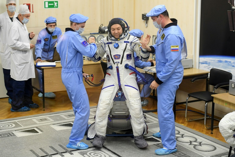 Russian, North American astronauts return to earth