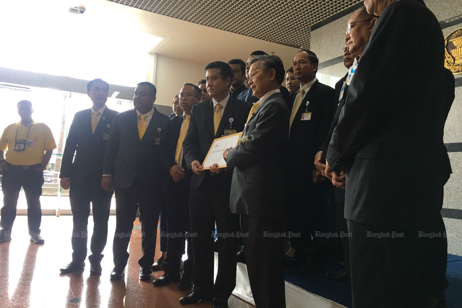 MPs of the Palang Pracharath Party file their petition against 33 opposition MPs with House Speaker Chuan Leekpai at the headquarters of TOT Plc in Bangkok on Thursday. (Photo by Aekarach Sattaburuth)