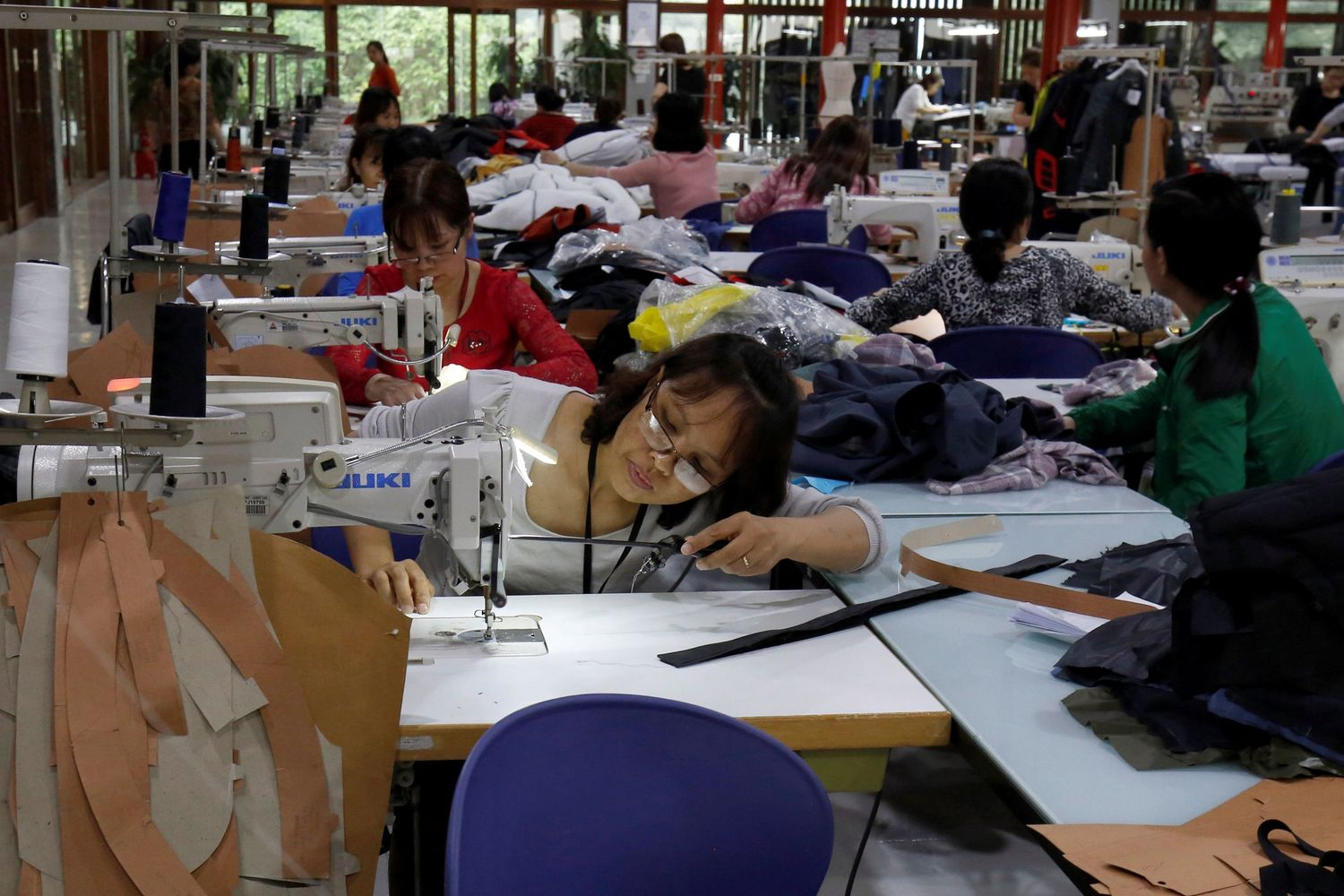 Labourers work at export garment Maxport factory in Hanoi in March this year. (Reuters photo)