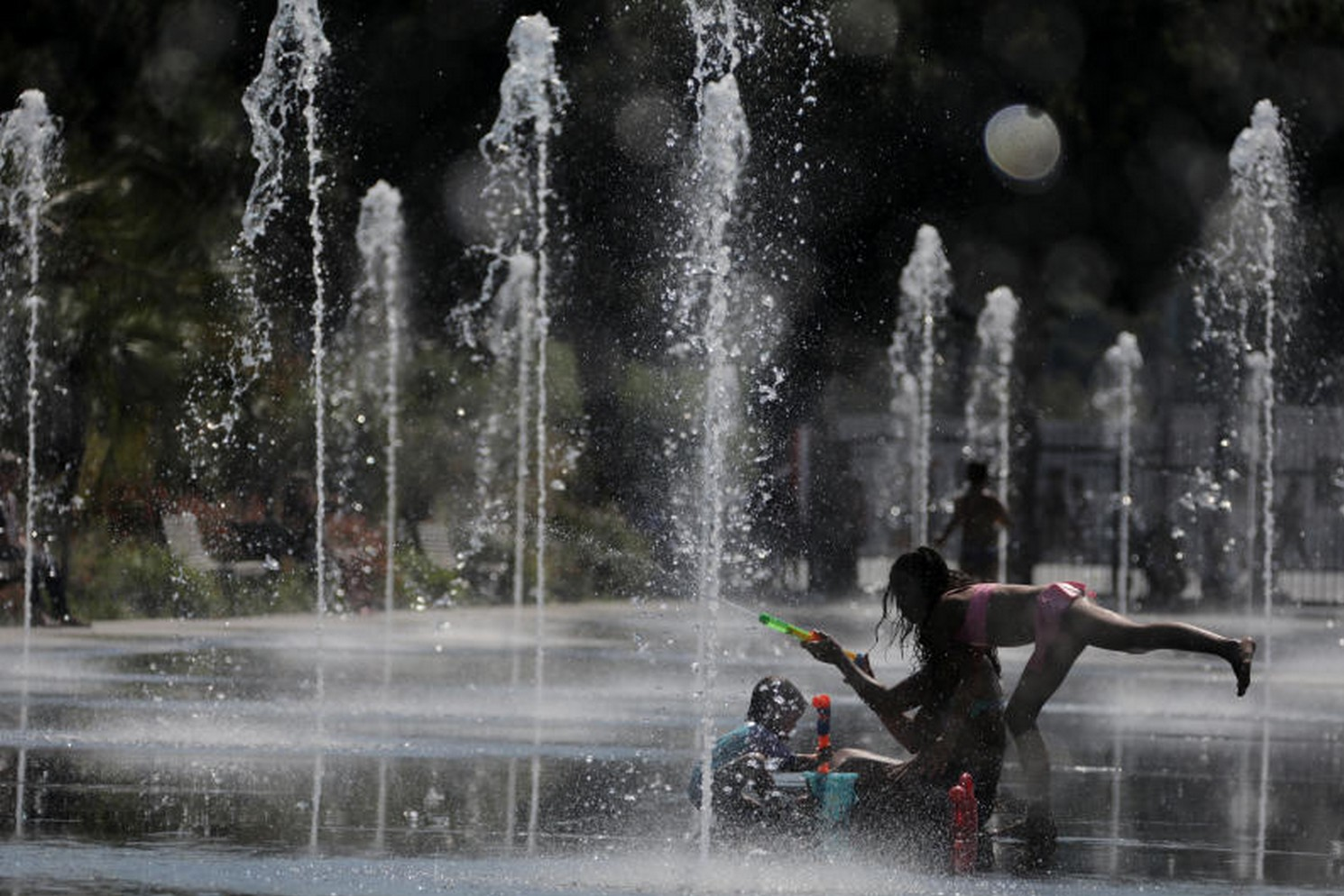 People cool off in a fountain in Nice, France, on Thursday as a heatwave continues over much of Europe. (Photo: Reuters)