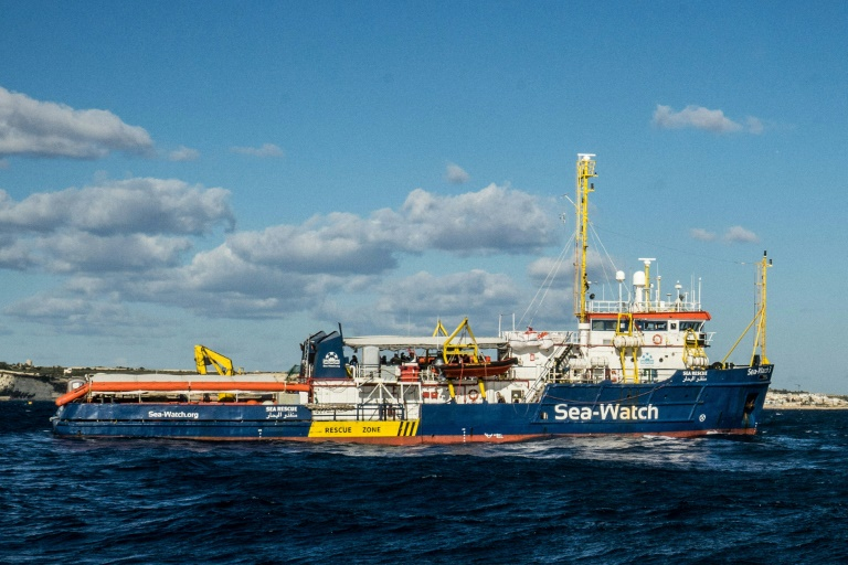 The Dutch-flagged rescue vessel Sea Watch 3 docked despite the best efforts of a coastguard boat to prevent her from doing so