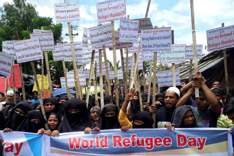 Rohingya refugees hold placards as they participate in a rally to observe World Refugee Day at the Rohingya refugee camp in Cox's Bazar, Bangladesh, June 20, 2019. (Reuters file photo)