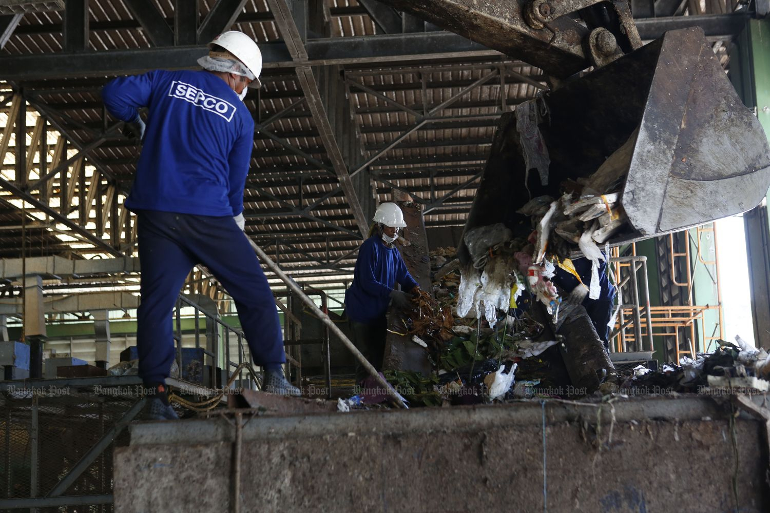 Workers from Global Power Synergy Plc sort garbage at a waste management centre in Muang district, Rayong province, in July 2018. (Bangkok Post file photo)