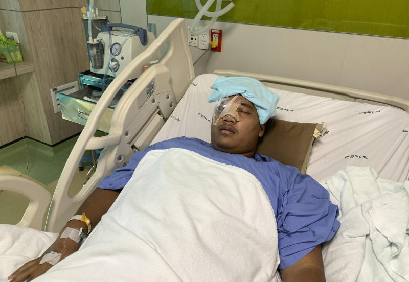 Pro-democracy leader Sirawith Seritiwat is hospitalised following last week's attack in Bangkok, on Wednesday (AP photo)