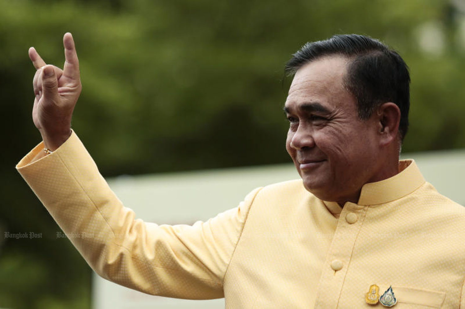 Prime Minister Prayut Chan-o-cha makes the gesture for