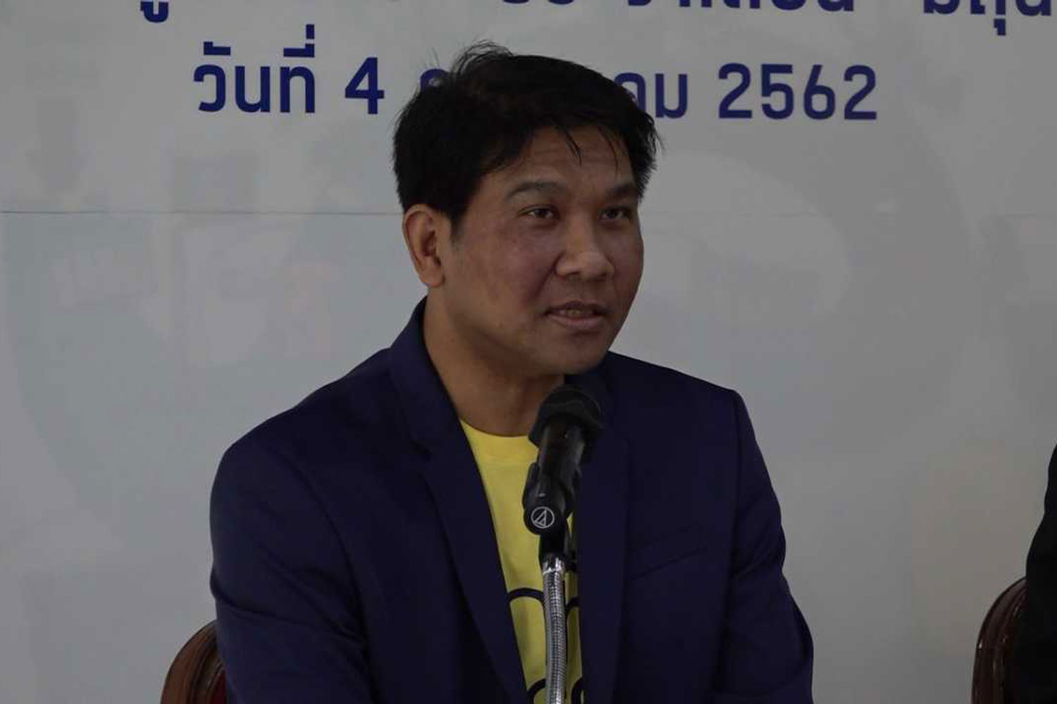 Thanavath Phonvichai, vice president of the University of the Thai Chamber of Commerce, announces results of its June consumer confidence survey in Bangkok on Thursday. (Photo supplied)
