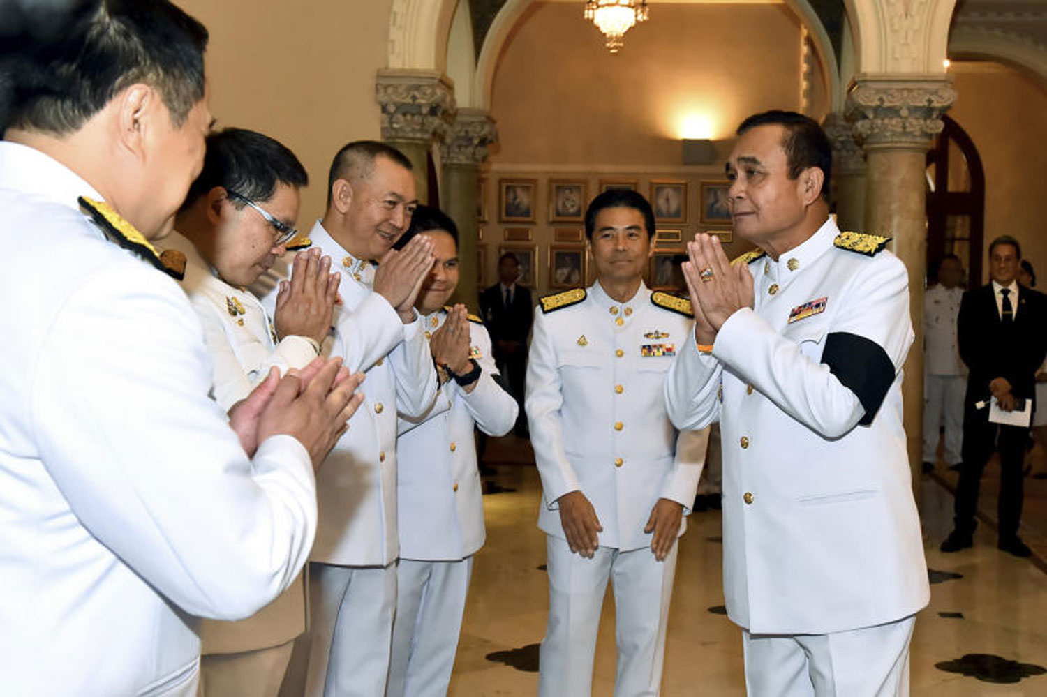 Gen Prayut Chan-o-cha greets leaders and representatives from coalition allies at Government House on June 11 after being appointed prime minister. (Government House photo)