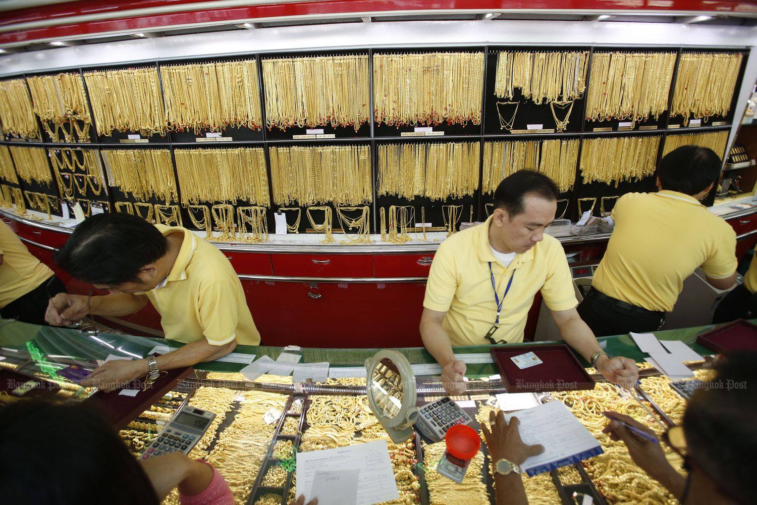 Gold dips as firm equities weigh, investors await U.S
