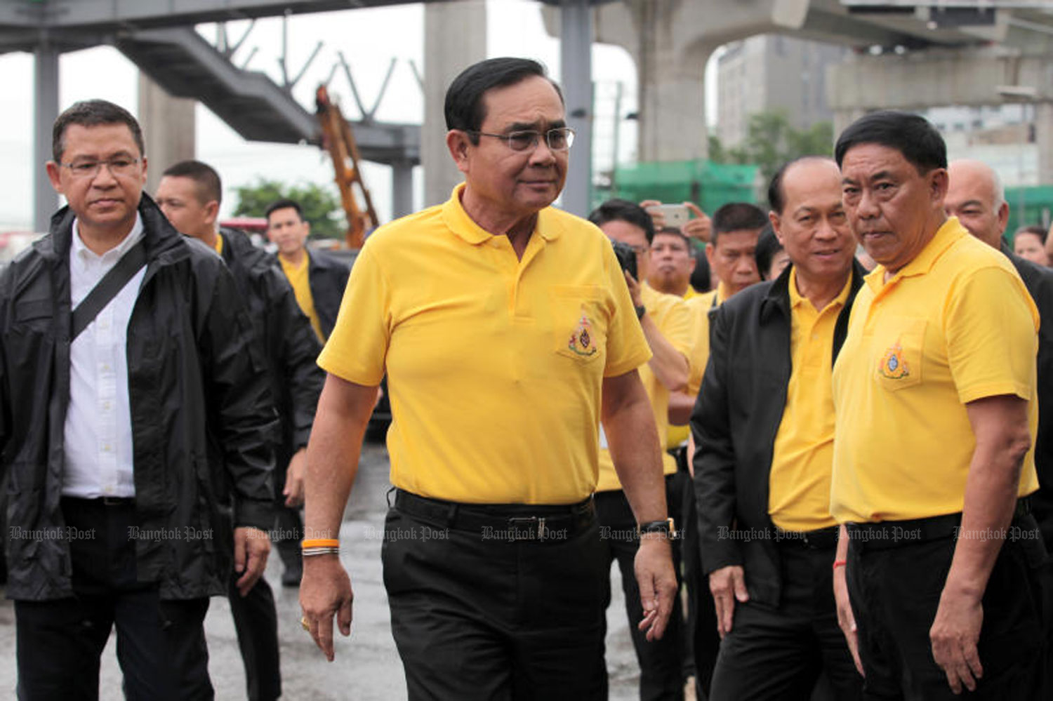 Prime Minister Prayut Chan-o-cha leads a visit on Friday to the construction sites of three flood-prevention projects in Bang Khen district of the capital. (Photo by Chanat Katanyu)