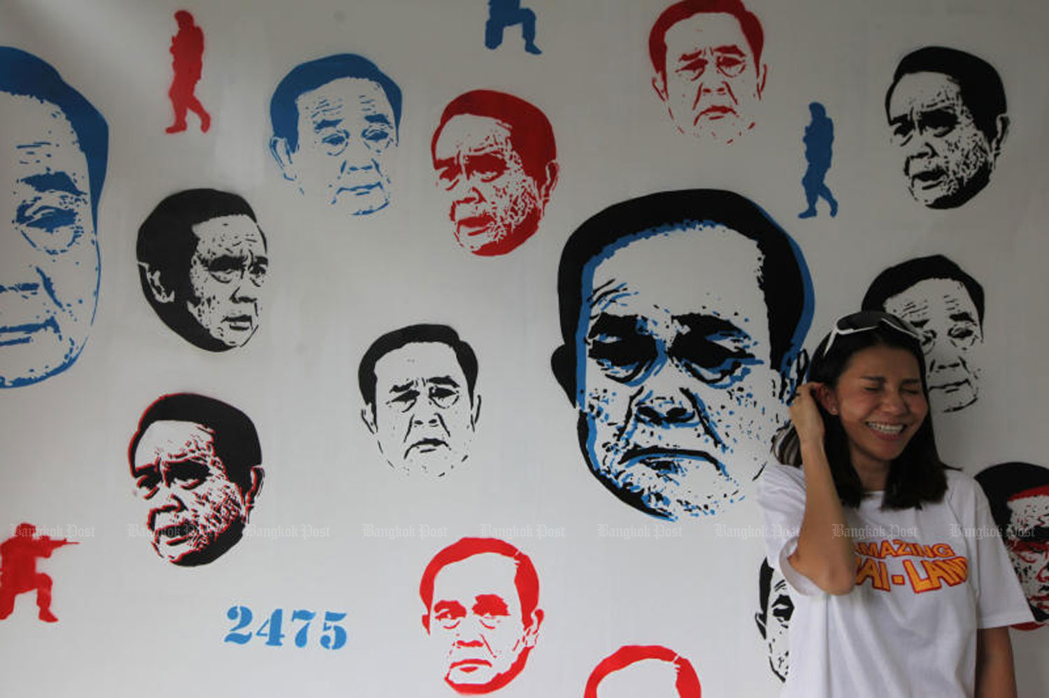 Different facial emotions of Prime Minister Prayut Chan-o-cha are painted under a theme 'Uncensored' by a group of artists named 'Headache Stencil.' The one-day exhibition was held at The Jam Factory on Charoen Nakhon Road in Bangkok on Sunday. (Photo by Wichan Charoenkiatpakul)