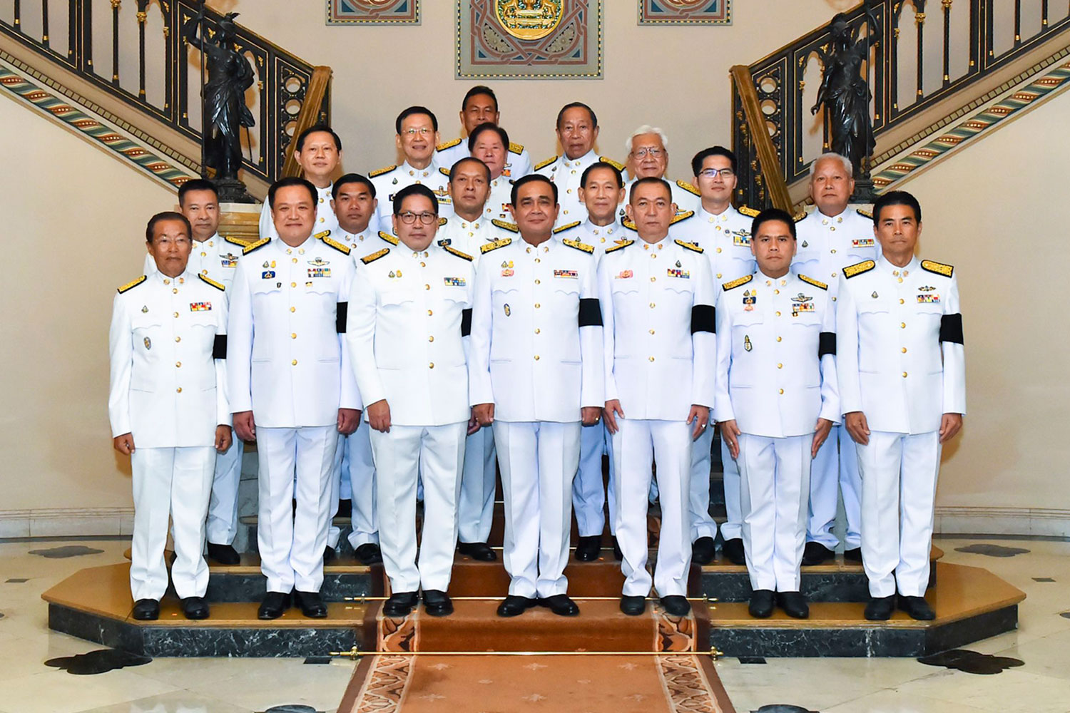 Prayut Chan-o-cha, centre, poses with representatives of coalition parties at Government House after receiving the royal command appointing him prime minister on June 11. The World Bank warns that lingering doubts about the cohesiveness of the 19-party government could affect investor and consumer confidence, and further delay major public infrastructure projects. (Government House photo)