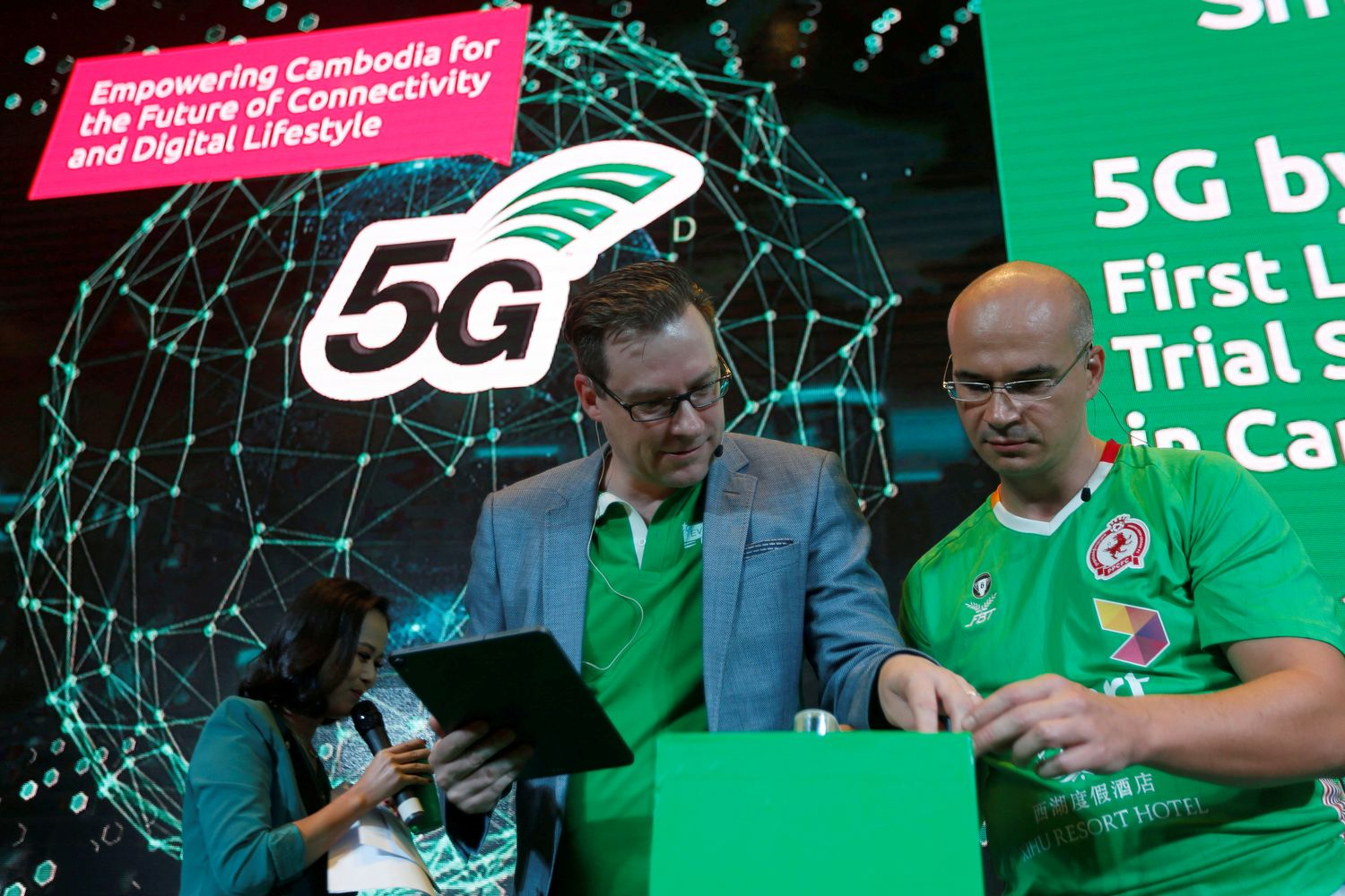 Thomas Hundt, CEO of Smart Axiata, gestures during a 5G launching ceremony at the Smart Axiata Telecommunications company in Phnom Penh on Monday. (Reuters photo)