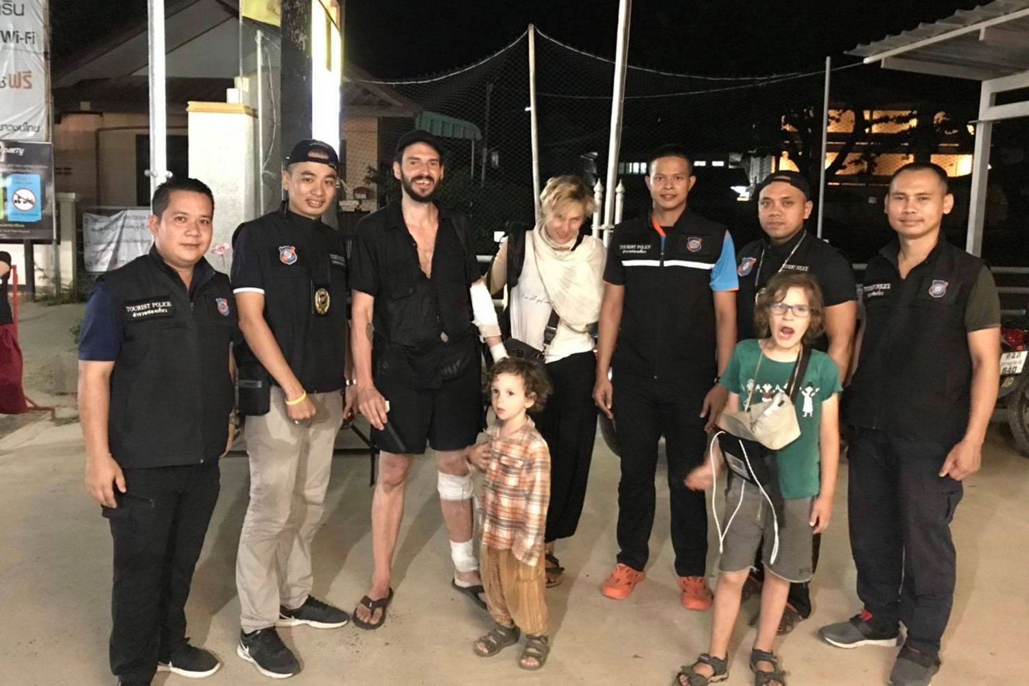 The Polish family poses with local tourist police after being found in a hilly forest on Koh Phangan in Surat Thani province on Monday night. They had gone for a walk to take in the views on Monday and were unable to find their way back to their hotel. (Photo from the Tourist Police Division 3)