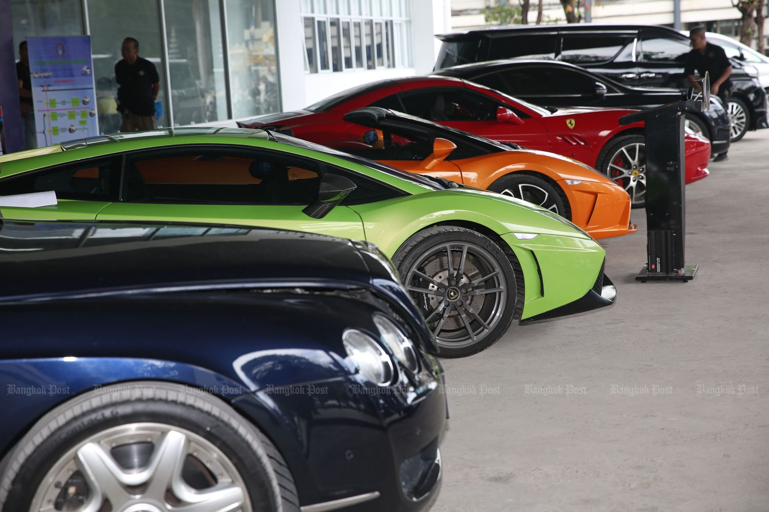 Imported luxury cars with forged registration numbers and papers are shown at the Crime Suppression Division in Bangkok in May. (Photo by Varuth Hirunyatheb)
